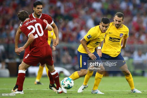 Angel Correa of Atletico Madrid and Adam Lallana of Liverpool during the Audi Cup 2017 match between Liverpool FC and Atletico Madrid at Allianz...