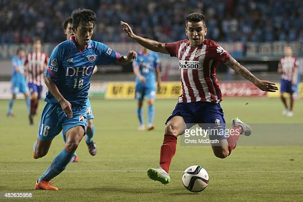 Angel Correa of Atletico Madrid takes a shot at goal under pressure from Choi Sung Keun of Sagan Tosu FC during the friendly match between Atletico...