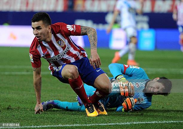 Angel Correa of Club Atletico de Madrid celebrates after scoring his team's 3rd goal beside an injured German Dario Lux of RC Deportivo La Coruna...