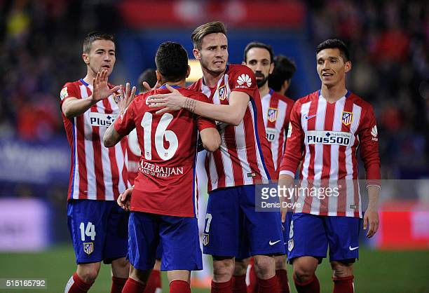 Angel Correa of Club Atletico de Madrid celebrates with Saul Niguez after scoring his team's 3rd goal during the La Liga match between Club Atletico...