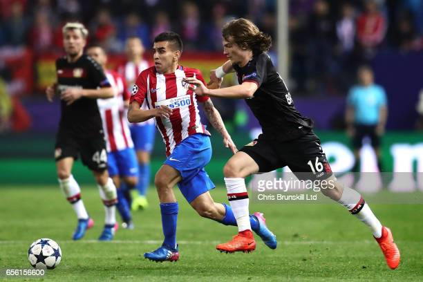 Angel Correa of Club Atletico de Madrid is challenged by Tin Jedvaj of Bayer Leverkusen during the UEFA Champions League Round of 16 second leg match...