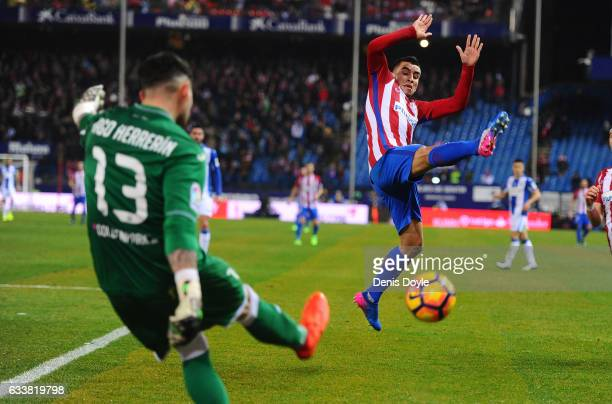 Angel Correa of Club Atletico de Madrid tries to block a clearance from Iago Herrerin of CD Leganes during the La Liga match between Club Atletico de...