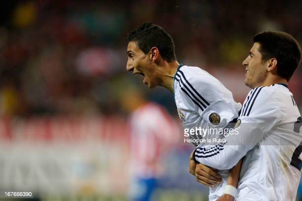 Angel de Di Maria and Alvaro Morata of Real Madrid celebrate after scoring during the La Liga match between Atletico de Madrid and Real Madrid at...