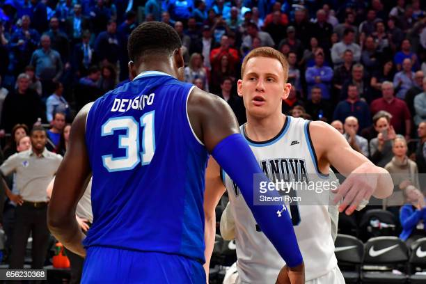 Angel Delgado of the Seton Hall Pirates shakes embraces Donte DiVincenzo of the Villanova Wildcats after his teams loss during the Big East...