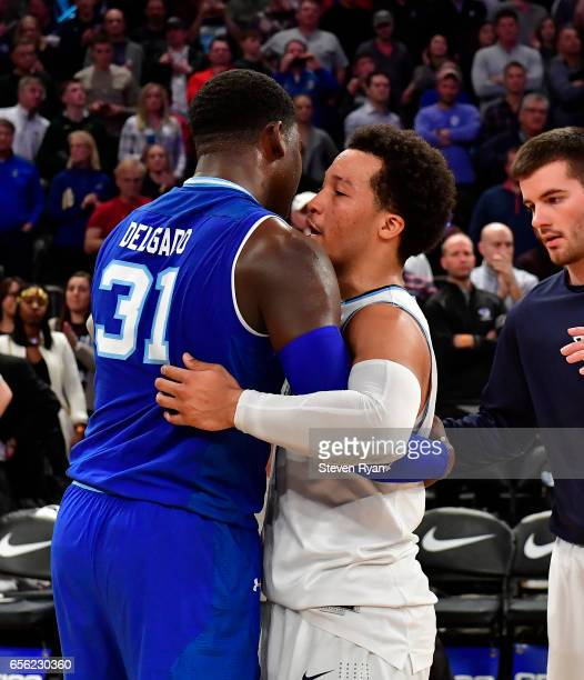 Angel Delgado of the Seton Hall Pirates shakes embraces Jalen Brunson of the Villanova Wildcats after his teams loss during the Big East Basketball...