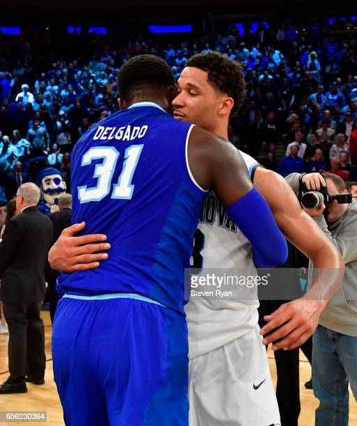 Angel Delgado of the Seton Hall Pirates shakes embraces Josh Hart of the Villanova Wildcats after his teams loss during the Big East Basketball...