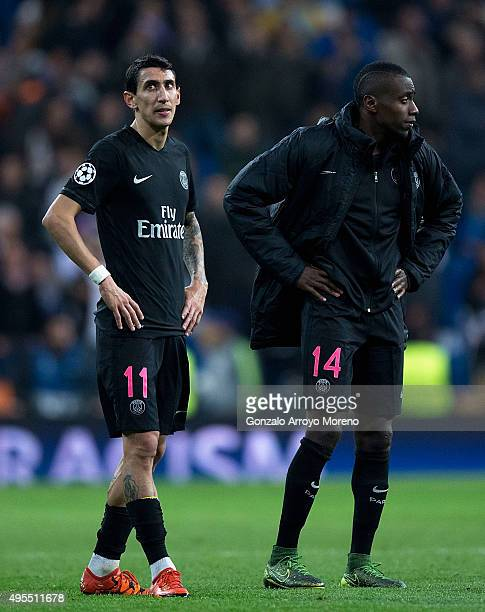 Angel Di Maria and Blaise Matuidi of PSG look despondent in defeat after the UEFA Champions League Group A match between Real Madrid CF and Paris...