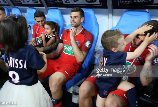 Angel Di Maria and his daughter Mia di Maria Thiago Motta Marco Verratti of PSG and his son Tommaso Verratti following the French Cup final between...