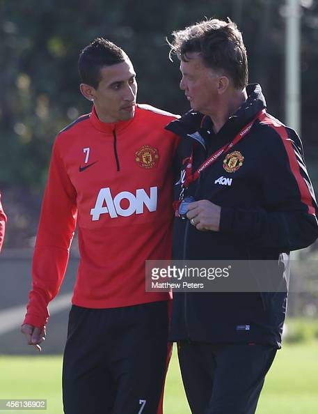 Angel di Maria and Manager Louis van Gaal of Manchester United in action during a first team training session at Aon Training Complex on September 26...