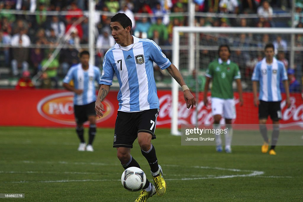<a gi-track='captionPersonalityLinkClicked' href=/galleries/search?phrase=Angel+Di+Maria&family=editorial&specificpeople=4110691 ng-click='$event.stopPropagation()'>Angel Di Maria</a> dominates the ball during a match between Bolivia and Argentina as part of the 12th round of the South American Qualifiers for the FIFA World Cup Brazil 2014 at the Hernando Siles Stadium on March 26, 2013 in La Paz, Bolivia.