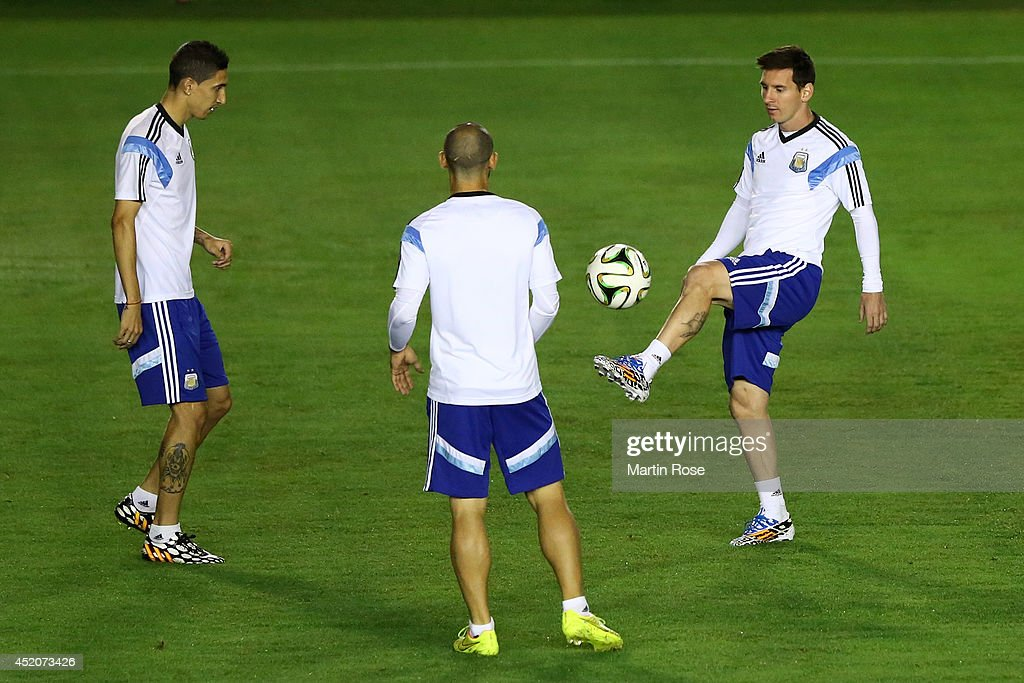 Angel di Maria, <a gi-track='captionPersonalityLinkClicked' href=/galleries/search?phrase=Javier+Mascherano&family=editorial&specificpeople=490876 ng-click='$event.stopPropagation()'>Javier Mascherano</a> and <a gi-track='captionPersonalityLinkClicked' href=/galleries/search?phrase=Lionel+Messi&family=editorial&specificpeople=453305 ng-click='$event.stopPropagation()'>Lionel Messi</a> of Argentina warm up during the Argentina training session, ahead of the 2014 FIFA World Cup Final, at Estadio Sao Januario on July 12, 2014 in Rio de Janeiro, Brazil.