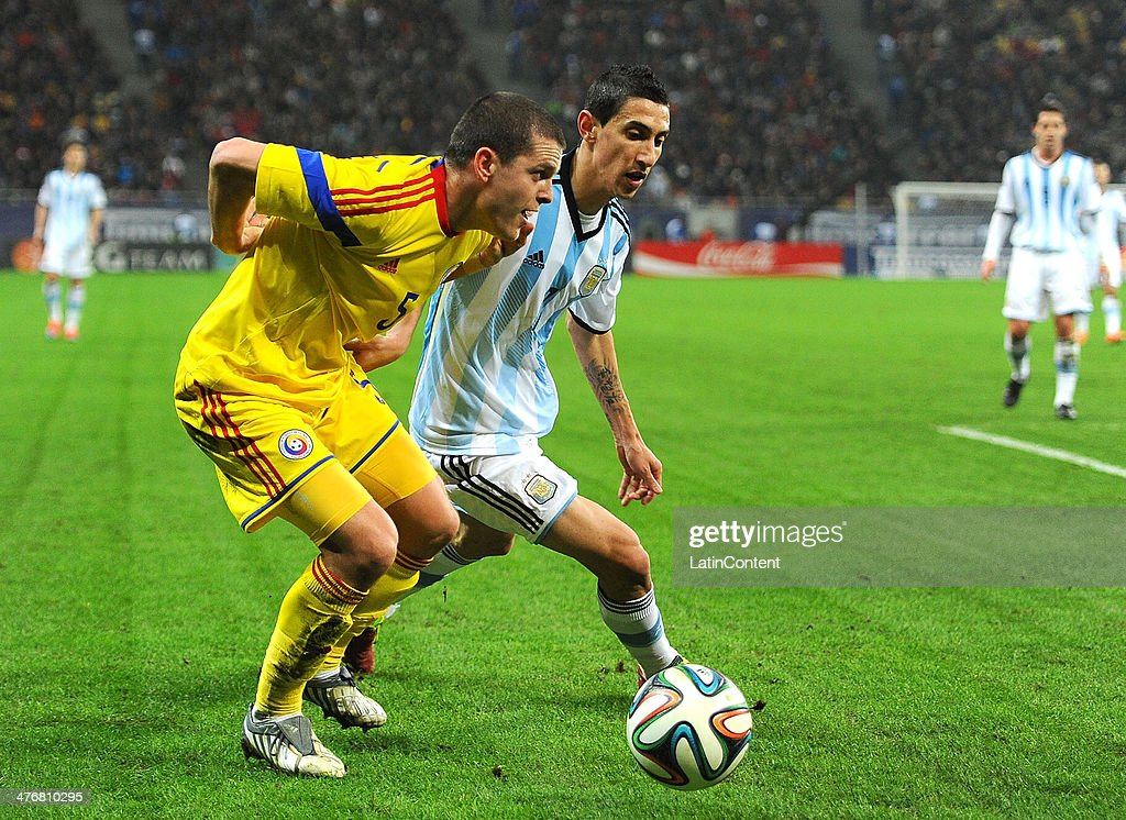 <a gi-track='captionPersonalityLinkClicked' href=/galleries/search?phrase=Angel+Di+Maria&family=editorial&specificpeople=4110691 ng-click='$event.stopPropagation()'>Angel Di Maria</a> (R) of Argentina and <a gi-track='captionPersonalityLinkClicked' href=/galleries/search?phrase=Alexandru+Bourceanu&family=editorial&specificpeople=6597771 ng-click='$event.stopPropagation()'>Alexandru Bourceanu</a> (L) of Romania battle for the ball during a friendly match between Romania and Argentina at Arena Nationala Stadium on March 05, 2014 in Bucharest, Romania.