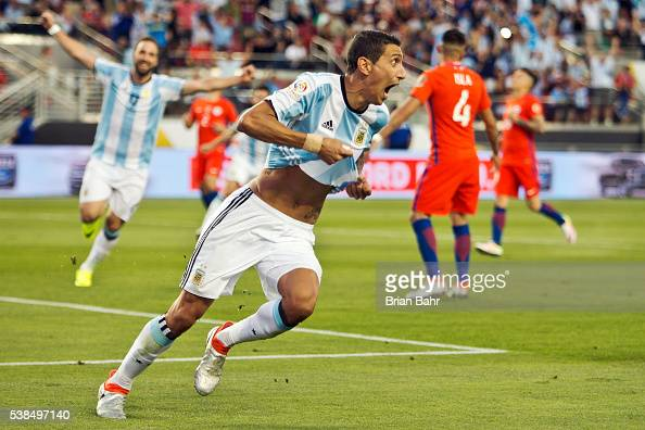Angel Di Maria of Argentina celebrates after scoring the first goal against Chile in the second half during a group D match between Argentina and...