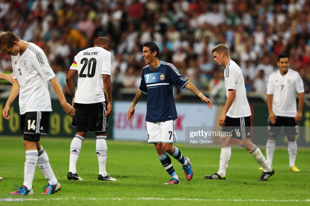 Angel di Maria of Argentina celebrates his team's third goal as <a gi-track='captionPersonalityLinkClicked' href=/galleries/search?phrase=Holger+Badstuber&family=editorial&specificpeople=4331362 ng-click='$event.stopPropagation()'>Holger Badstuber</a>, <a gi-track='captionPersonalityLinkClicked' href=/galleries/search?phrase=Jerome+Boateng&family=editorial&specificpeople=2192287 ng-click='$event.stopPropagation()'>Jerome Boateng</a>, <a gi-track='captionPersonalityLinkClicked' href=/galleries/search?phrase=Lars+Bender&family=editorial&specificpeople=644948 ng-click='$event.stopPropagation()'>Lars Bender</a> and Ilkay Guendogan (L-R) of Germany react during the international friendly match between Germany and Argentina at Commerzbank-Arena on August 15, 2012 in Frankfurt am Main, Germany.