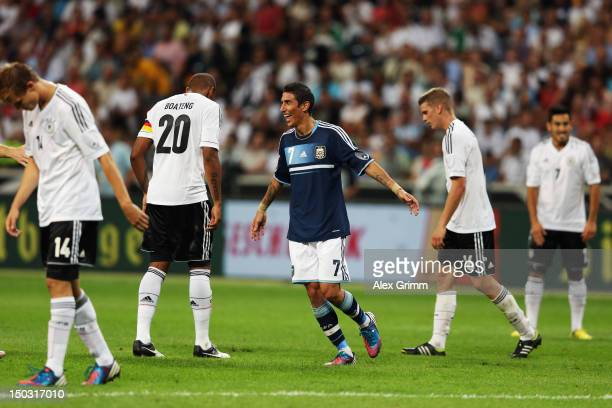 Angel di Maria of Argentina celebrates his team's third goal as Holger Badstuber Jerome Boateng Lars Bender and Ilkay Guendogan of Germany react...