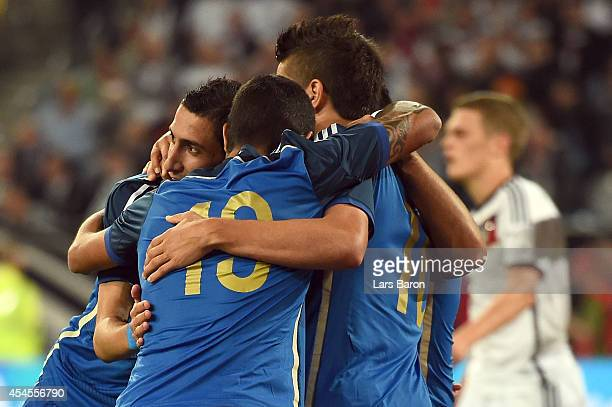 Angel di Maria of Argentina celebrates with team mates after scoring his teams fourth goal during the international friendly match between Germany...