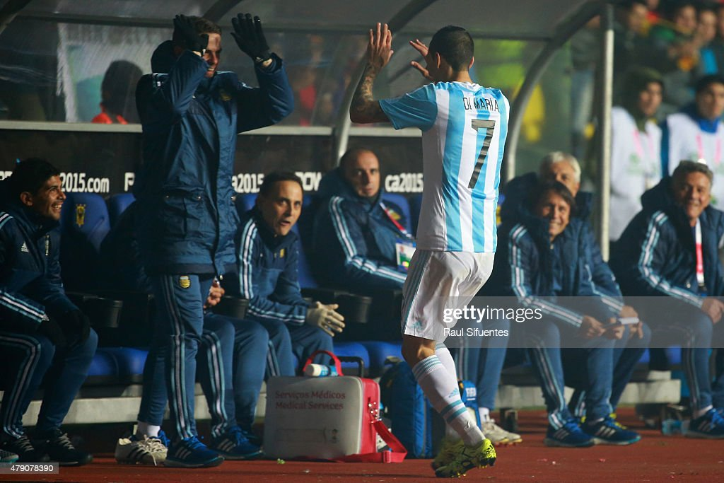 Angel di Maria of Argentina celebrates with teammate <a gi-track='captionPersonalityLinkClicked' href=/galleries/search?phrase=Fernando+Gago&family=editorial&specificpeople=674234 ng-click='$event.stopPropagation()'>Fernando Gago</a> after scoring the third goal of his team during the 2015 Copa America Chile Semi Final match between Argentina and Paraguay at Ester Roa Rebolledo Stadium on June 30, 2015 in Concepcion, Chile.