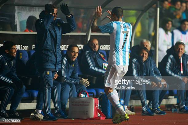 Angel di Maria of Argentina celebrates with teammate Fernando Gago after scoring the third goal of his team during the 2015 Copa America Chile Semi...