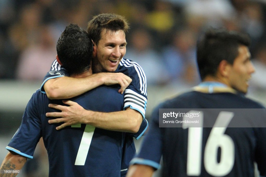 Angel di Maria of Argentina celebrates with teammate Lionel Messi after scoring his team's third goal during the international friendly match between Germany and Argentina and Commerzbank-Arena on August 15, 2012 in Frankfurt am Main, Germany.