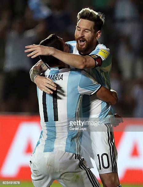 Angel Di Maria of Argentina celebrates with teammate Lionel Messi after scoring the third goal of his team during a match between Argentina and...