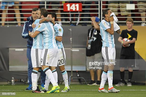 Angel Di Maria of Argentina celebrates with teammates after scoring the opening goal during a group D match between Argentina and Chile at Levi's...