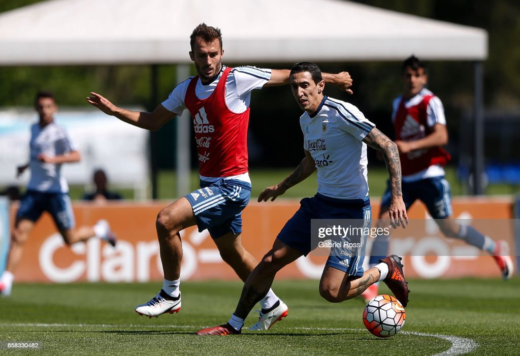 Angel Di Maria of Argentina fights for the ball with German Pezzella of Argentina during a training session at Argentine Football Association (AFA) 'Julio Humberto Grondona' training camp on October 06, 2017 in Ezeiza, Argentina.