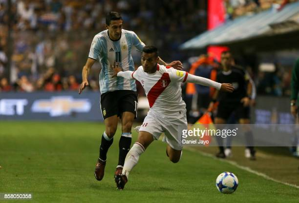 Angel Di Maria of Argentina fights for the ball with Miguel Trauco of Peru during a match between Argentina and Peru as part of FIFA 2018 World Cup...