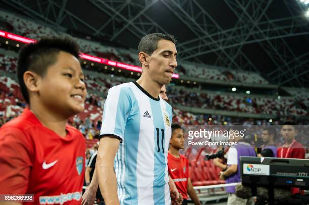 Angel Di Maria of Argentina getting into the field during the International Test match between Argentina and Singapore at National Stadium on June 13...
