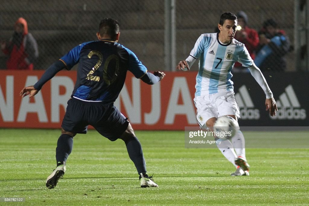 Angel Di Maria of Argentina (R) in action during a friendly game between Argentina and Honduras at Bicentenario stadium in San Juan, Argentina on May 27, 2016.