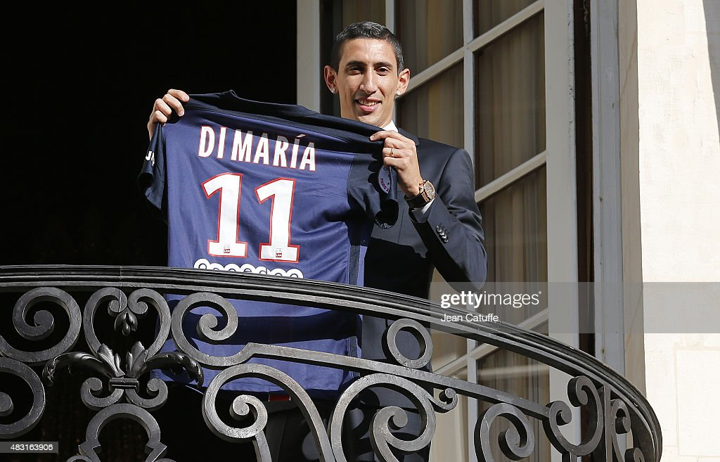 <a gi-track='captionPersonalityLinkClicked' href=/galleries/search?phrase=Angel+Di+Maria&family=editorial&specificpeople=4110691 ng-click='$event.stopPropagation()'>Angel Di Maria</a> of Argentina is presented as new player of Paris Saint-Germain (PSG) during a press conference and jersey presentation at Shangri-La hotel on August 6, 2015 in Paris, France.