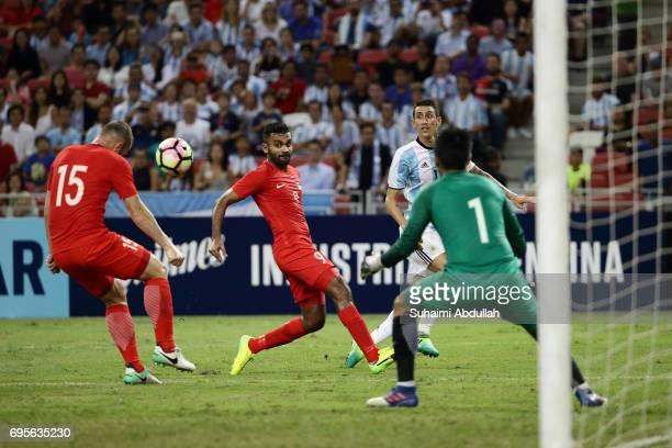 Angel Di Maria of Argentina makes a cross during the International Test match between Argentina and Singapore at National Stadium on June 13 2017 in...