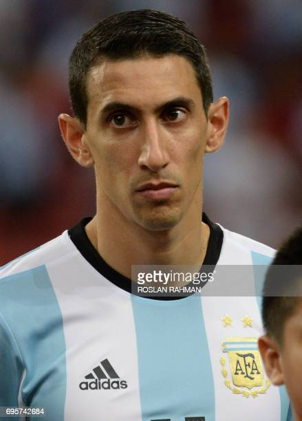 Angel Di Maria of Argentina poses before the start of their international friendly football match against Singapore at the National Stadium in...