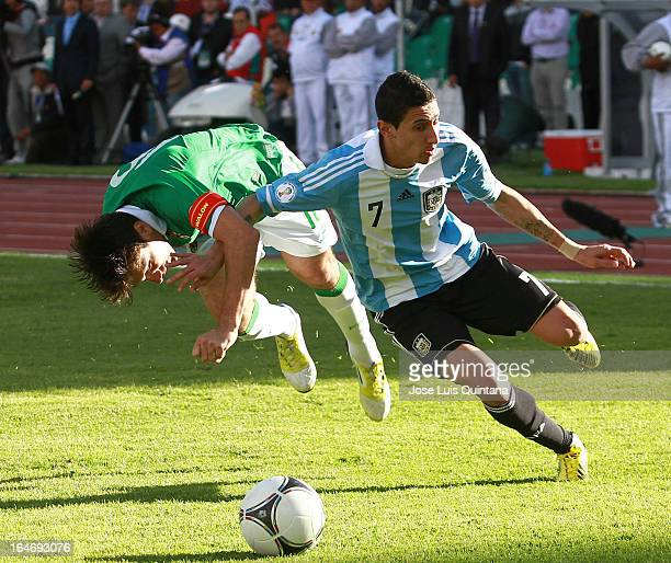 Angel Di Maria of Argentina secures the ball during a match between Bolivia and Argentina as part of the 12th round of the South American Qualifiers...