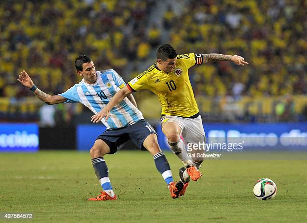 Angel Di Maria of Argentina struggles for the ball with James Rodriguez of Colombia during a match between Colombia and Argentina as part of FIFA...