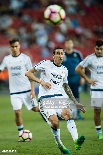 Angel Di Maria of Argentina warming up during the International Test match between Argentina and Singapore at National Stadium on June 13 2017 in...
