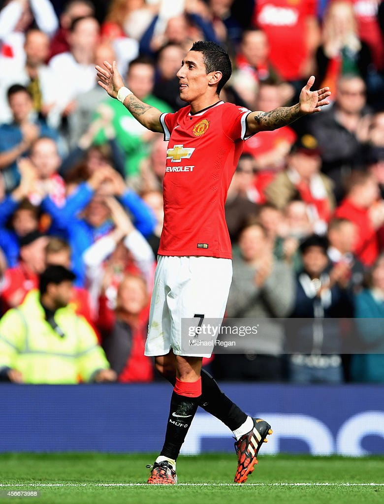 Angel Di Maria of Manchester United celebrates scoring the first goal during the Barclays Premier League match between Manchester United and Everton at Old Trafford on October 5, 2014 in Manchester, England.