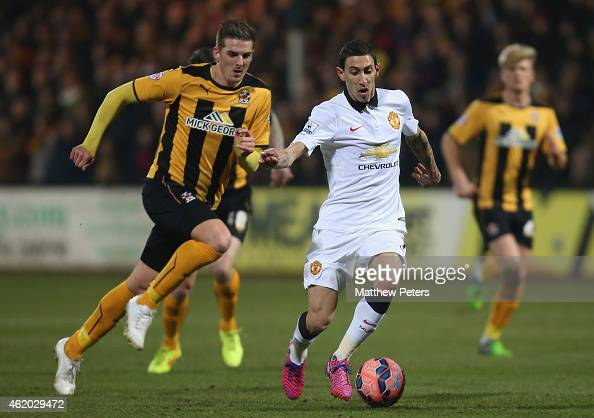 Angel di Maria of Manchester United in action with Liam Hughes of Cambridge United during the FA Cup Fourth Round match between Cambridge United and...