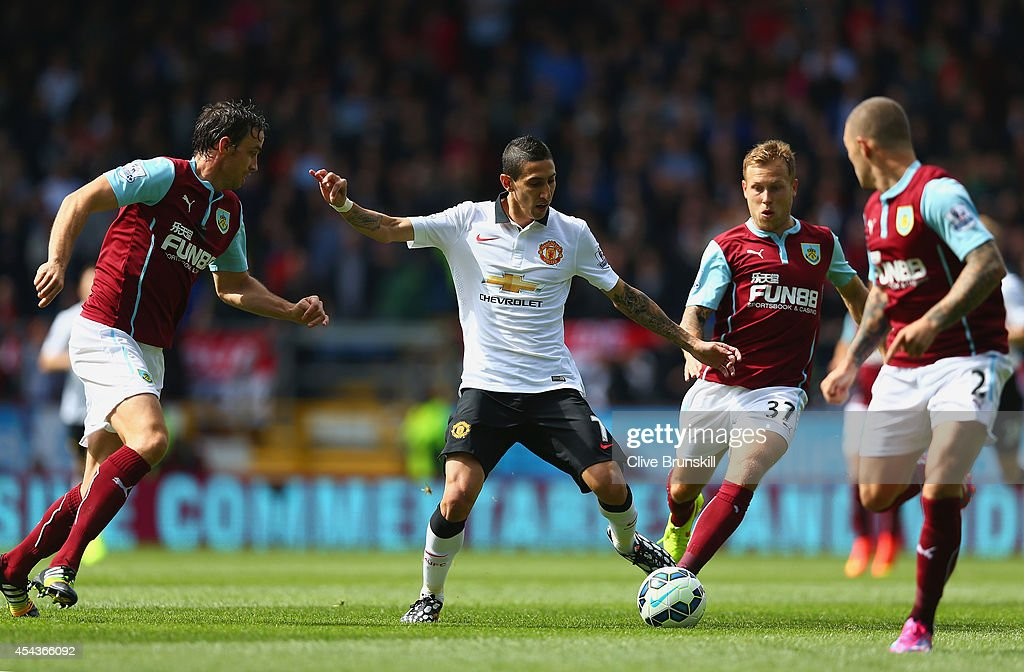 Angel di Maria of Manchester United looks for a way through the Burnley defense during the Barclays Premier League match between Burnley and Manchester United at Turf Moor on August 30, 2014 in Burnley, England.