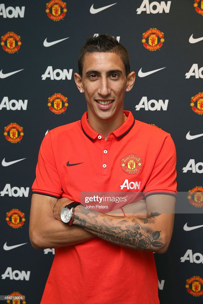 Angel di Maria of Manchester United poses after signing for the club at Aon Training Complex on August 26, 2014 in Manchester, England.
