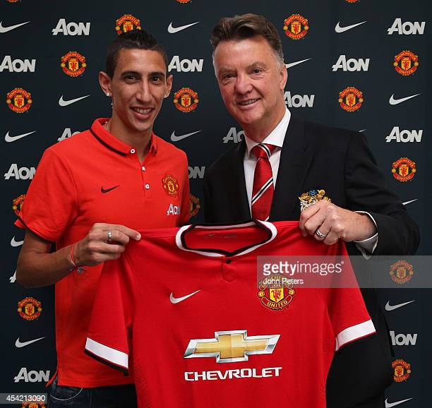 Angel di Maria of Manchester United poses with manager Louis van Gaal after signing for the club at Aon Training Complex on August 26 2014 in...