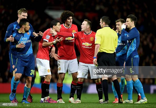 Angel di Maria of Manchester United remonstrates with referee Michael Oliver as he receives the yellow card during the FA Cup Quarter Final match...