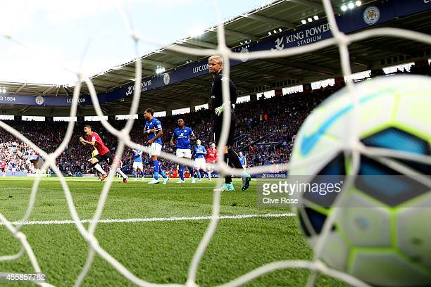 Angel di Maria of Manchester United turns away to celebrate after scoring his team's second goal as a dejected Kasper Schmeichel of Leicester City...