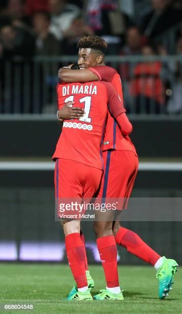 Angel Di Maria of Paris Saint Germain celebrate with Presnel Kimpembe of Paris Saint Germain during the Ligue 1 match between Angers SCO and Paris...