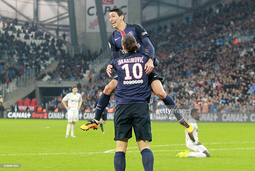 Angel Di Maria of Paris Saint-Germain celebrate his goal of the victory with <a gi-track='captionPersonalityLinkClicked' href=/galleries/search?phrase=Zlatan+Ibrahimovic&family=editorial&specificpeople=206139 ng-click='$event.stopPropagation()'>Zlatan Ibrahimovic</a> during the French Ligue 1 between Olympique de Marseille and Paris Saint-Germain at Stade Velodrome on february 7, 2016 in Marseille, France.