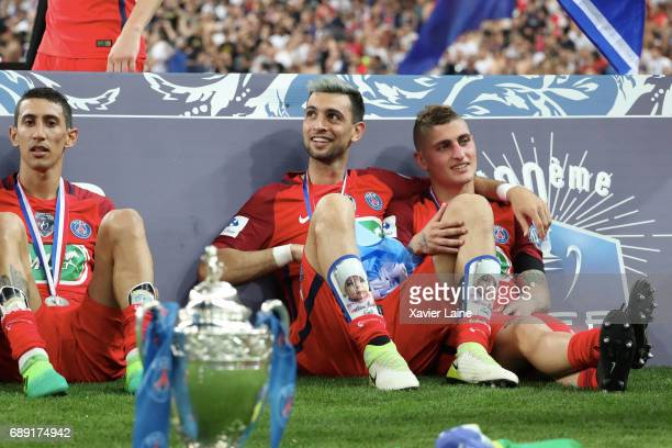 Angel Di Maria of Paris SaintGermain celebrate the cup with Javier Pastore and Marco Verratti during the French Cup Final match between Paris...
