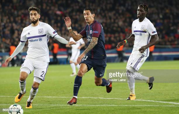 Angel Di Maria of Paris SaintGermain in action with Josue Sa and Serigne Mbodji of Anderlecht RSC during the UEFA Champions League group B match...