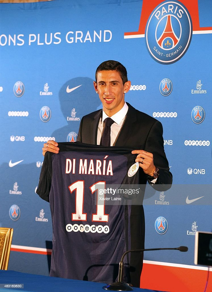 <a gi-track='captionPersonalityLinkClicked' href=/galleries/search?phrase=Angel+Di+Maria&family=editorial&specificpeople=4110691 ng-click='$event.stopPropagation()'>Angel Di Maria</a> of Paris Saint-Germain pose during his official presentation after signing for PSG at Shangri-La Hotel Paris on August 6, 2015 in Paris, France.