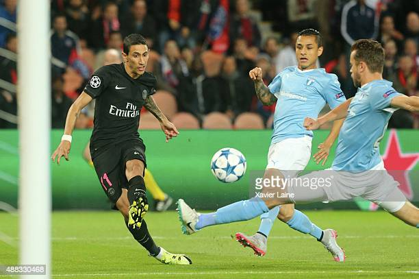 Angel Di Maria of Paris SaintGermain scores the opening goal during the UEFA Champions League between Paris SaintGermain and Malmo FF at Parc Des...