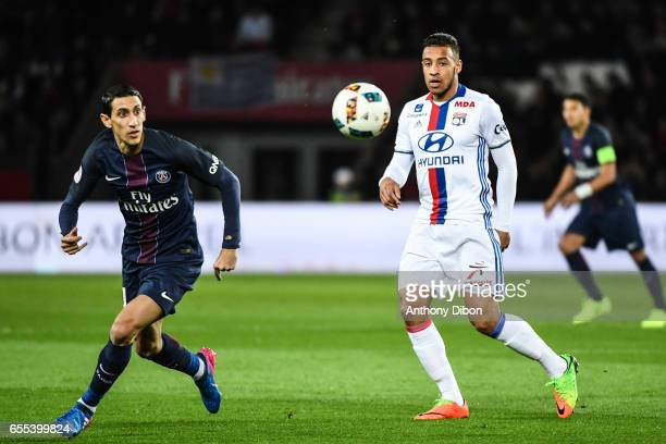 Angel Di Maria of PSG and Corentin Tolisso of Lyon during the French Ligue 1 match between Paris Saint Germain and Lyon at Parc des Princes on March...