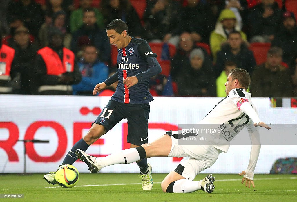 Angel Di Maria of PSG and Sylvain Armand of Rennes in action during the French Ligue 1 match between Paris Saint-Germain (PSG) and Stade Rennais FC at Parc des Princes stadium on April 29, 2016 in Paris, France.